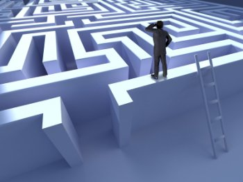 A Man peering into a maze, he may be thinking it's too difficult to choose a quality website designer